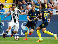 Calcio, Serie A: Inter vs Juventus. Milano, stadio San Siro, 18 settembre 2016.<br /> Juventus&rsquo; Paulo Dybala, left, is challenged by Inter's Davide Santon, center, and Jeison Murillo, during the Italian Serie A football match between FC Inter and Juventus at Milan's San Siro stadium, 18 September 2016.<br /> UPDATE IMAGES PRESS/Isabella Bonotto