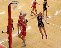 28.10.2014 Silver Ferns Katrina Grant and England's Rachel Dunn in action during the Silver Ferns V England netball match played at the Rotorua Events Centre in Rotorua. Mandatory Photo Credit ©Michael Bradley.