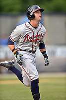 Rome Braves right fielder Braxton Davidson (24) runs to first during a game against the Asheville Tourists on May 15, 2015 in Asheville, North Carolina. The Braves defeated the Tourists 6-0. (Tony Farlow/Four Seam Images)