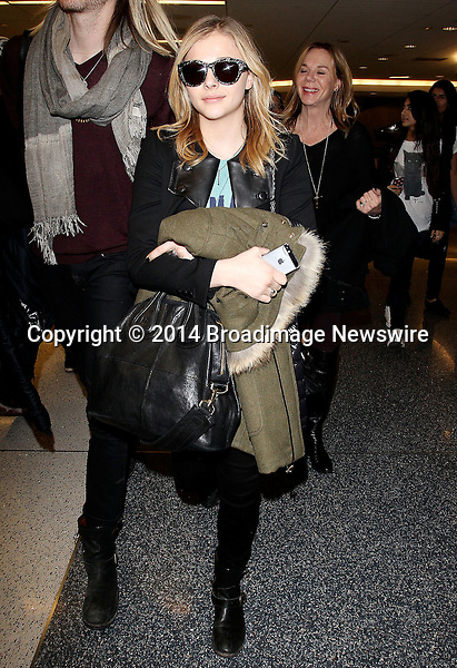 Pictured: Chloe Moretz<br /> Mandatory Credit &copy; CALA/Broadimage<br /> Chloe Moretz arrives at the Los Angeles International Airport<br /> <br /> 1/19/14, Los Angeles, California, United States of America<br /> <br /> Broadimage Newswire<br /> Los Angeles 1+  (310) 301-1027<br /> New York      1+  (646) 827-9134<br /> sales@broadimage.com<br /> http://www.broadimage.com