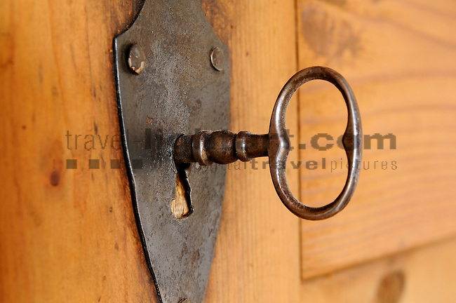 Key in lock, in an old house, in Malans, Grisons, Switzerland. Schlüssel in Türschloss in altem Haus in Malans, Graubünden, Schweiz.
