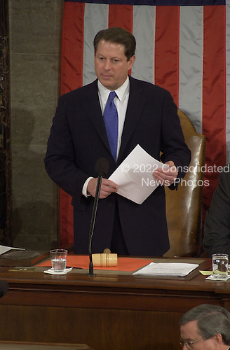 United States Vice President Al Gore certifies the Electorial College vote electing George W. Bush as President and Dick Cheney as Vice President of the United States in the U.S. House Chamber in Washington, D.C. on January 6, 2001..Credit: Ron Sachs / CNP