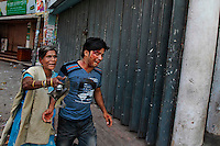 A Bangladeshi woman rushes an injured protestor to a safer location after activists of the main opposition group, the Bangladesh Nationalist Party (BNP), clashed with police in Dhaka, Bangladesh.