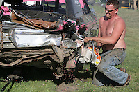 Driver Nick DeLange fixes his car between heats-Demolition Derby at the NW Washington Fair. August 17, 2009 PHOTOS BY MERYL SCHENKER