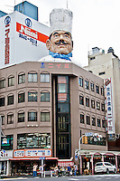 "Giant chefs head sticking out of building in Tokyo`s Kappabashi district - know as ""kitchen tool town""."