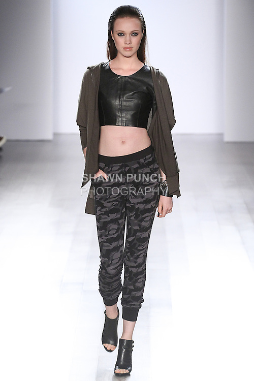Model walks runway in an outfit from the Serena William Signature Statement collection fashion show at Style360, during New York Fashion Week Spring 2015.