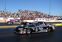 Jul. 31, 2011; Sonoma, CA, USA; NHRA pro stock driver Erica Enders (near) races alongside Vincent Nobile during the Fram Autolite Nationals at Infineon Raceway. Mandatory Credit: Mark J. Rebilas-