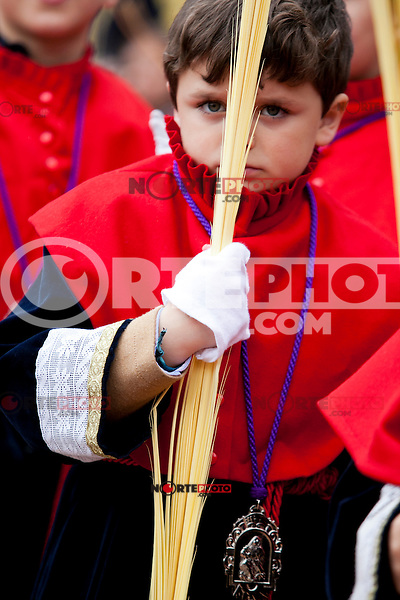 A child, member of a brotherhood files through the streets of Valladolid during a procession in the Holy Week of Spain. This Palmas Procession symbolize the entry of Jesuschrist in Jerusalem. Valladolid, Spain. March 24, 2013 (Victor Blanco/ Alterphotos) /NortePhoto