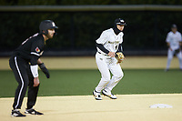 Wake Forest Demon Deacons second baseman DJ Poteet (4) on defense against the Louisville Cardinals at David F. Couch Ballpark on March 6, 2020 in  Winston-Salem, North Carolina. The Cardinals defeated the Demon Deacons 4-1. (Brian Westerholt/Four Seam Images)
