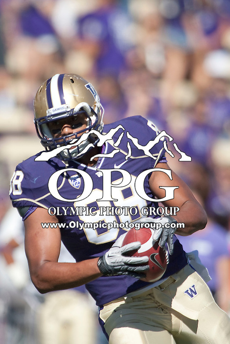 Sept 3, 2011:  Washington tight end Austin Seferian-Jenkins warms up before the game against Eastern Washington.  Washington defeated Eastern Washington 30-27 at Husky Stadium in Seattle, Washington...