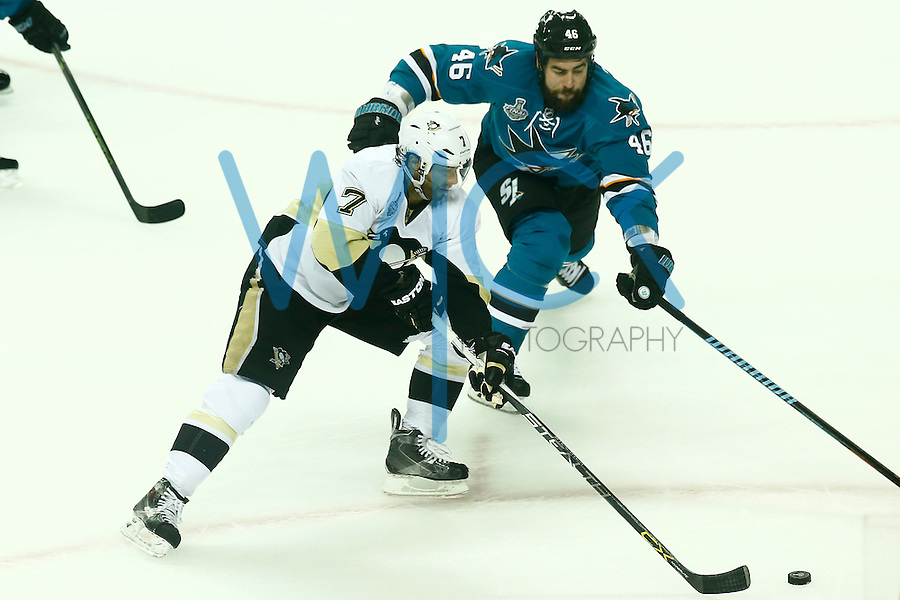 Matt Cullen #7 of the Pittsburgh Penguins carries the puck up the ice past Roman Polak #46 of the San Jose Sharks in the first period during game three of the Stanley Cup Final at the SAP Center in San Jose, California on June 4, 2016. (Photo by Jared Wickerham / DKPS)