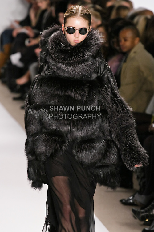 Alisa Matviychuk walks the runway in a gunmetal russian broadtail and fox coat, and black chiffon lace gown, by Dennis Basso for his Dennis Basso Fall Winter 2010 collection fashion show, during Mercedes-Benz Fashion Week Fall 2010.