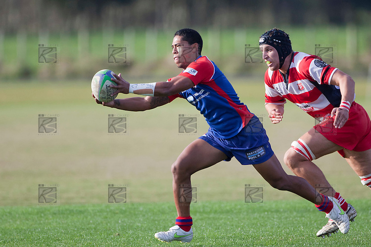 Danny Tusitala is chased across field by Nicholas Denz. Counties Manukau Premier Club Rugby game between Ardmore Marist and Karaka played at Bruce Pulman Park Papakura on Saturday June 11th 2011. Karaka won 42 - 25 after leading 21 - 18 at the break.