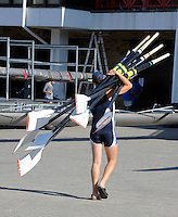 Poznan, POLAND,    GV Boating area, rower carrying blades, after morning training session in preparation for the 2009 FISA World Rowing Championships. held on the Malta Rowing lake, Friday  21/08/2009  [Mandatory Credit. Peter Spurrier/Intersport Images]