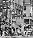 Pittsburgh PA:  View east on Liberty Avenue toward Pennsylvania Railroad Station - 1950s.  Businesses on the north side (600 block) of the street include: Kings Clothing Store, Lomakin Music, Robert's Restaurant & Bar, Pettey Musical Instruments, and Western Union.