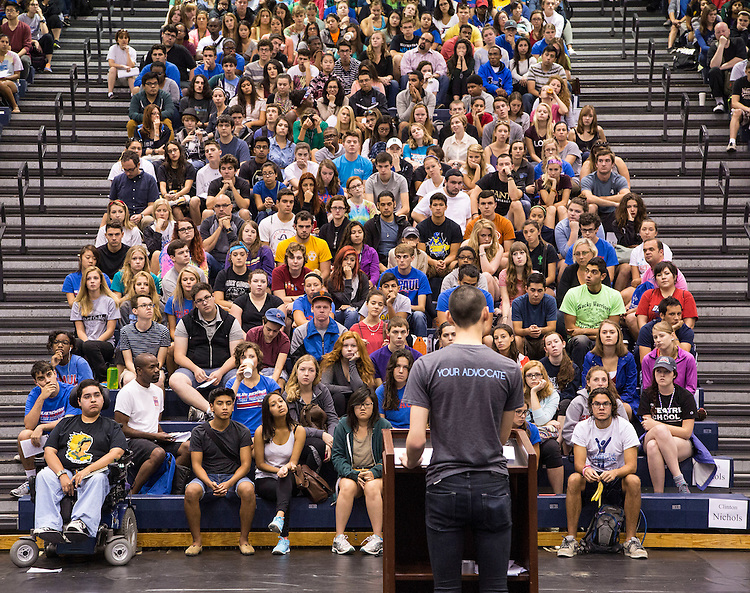 Student body president Matthew von Nida greets the students gathered in the McGrath-Phillips Arena Tuesday morning, Sept. 9, 2014, as they begin the annual New Student Service Day at DePaul University. Following a rally at the arena, students fanned out across the city, volunteering and assisting at various community organizations. <br /> <br /> DePaul hosts three major annual service days: New Student Service Day, A Day with Vincent - A Faculty &amp; Staff Service Day, and Vincentian Service Day. The goal of service days is to provide a Vincentian experience for all members of the DePaul community, engaging students, faculty and staff in a day of service, which serves to further establish long-term, mutually beneficial, and sustainable relationships with community partners working on a wide-range of impact issues across the Chicago metro region. (DePaul University/Jamie Moncrief)