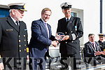 An Taoiseach Enda Kenny presents Tony Donnelly OIC Iveragh Coast Guard with a plaque to commemorate his retirement at the end of the week after 35 years of service to the Irish Coast Guards with left Declan Geoghegan, SAR Operations Manager ICG.