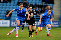 Tom Eaves of Gillingham takes the ball past Bury's Jay O'Shea during Gillingham vs Bury, Sky Bet EFL League 1 Football at the MEMS Priestfield Stadium on 11th November 2017