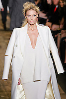Anja Rubik walks the runway in a white melton chesterfield, white cashmere pullover, white cashmere skirt at the Michael Kors Fall 2010 runway fashion show, during Mercedes-Benz Fashion Week Fall 2010.