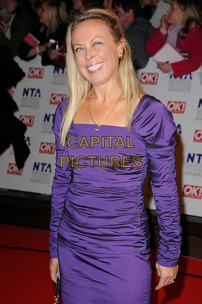 JANE TORVIL.The 15th National Television Awards held at the O2 Arena, London, England..January 20th, 2010.NTA NTAs half length purple ruched dress .CAP/CAS.©Bob Cass/Capital Pictures.