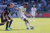 Portland, Oregon - Sunday October 6, 2019: Jeremy Ebobisse #17 shields the ball from Nick Lima #24 and Jackson Yueill #14 during a regular season match between Portland Timbers and San Jose Earthquakes at Providence Park in Portland, Oregon.