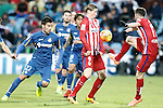 Getafe's Juan Rodriguez (l) and Damian Suarez (c-l) and Atletico de Madrid's Fernando Torres (c-r) and Saul Niguez during La Liga match. February 14,2016. (ALTERPHOTOS/Acero)