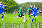 Fenit Samphires John Maher shoots for goal against Abbeyfeale's Timmy Gleeson in the FAI Junior cup at Fenit on Saturday.