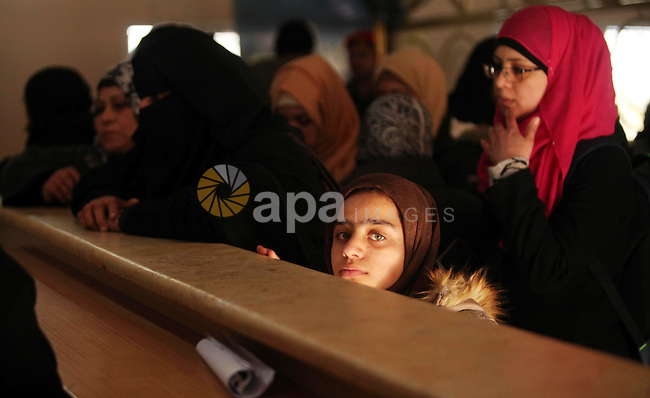 Palestinians wait for travel permits to cross into Egypt through the Rafah border crossing after it was opened by Egyptian authorities for humanitarian cases, in Rafah in the southern Gaza Strip on February 11, 2017. Photo by Ashraf Amra