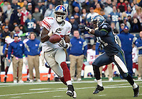New York Giants  wide receiver Plaxico Burress hauled in a Eli Manning pass for a first down in the final minutes of the fourth quarter against the Seattle Seahawks  at Quest Field in Seattle, WA.