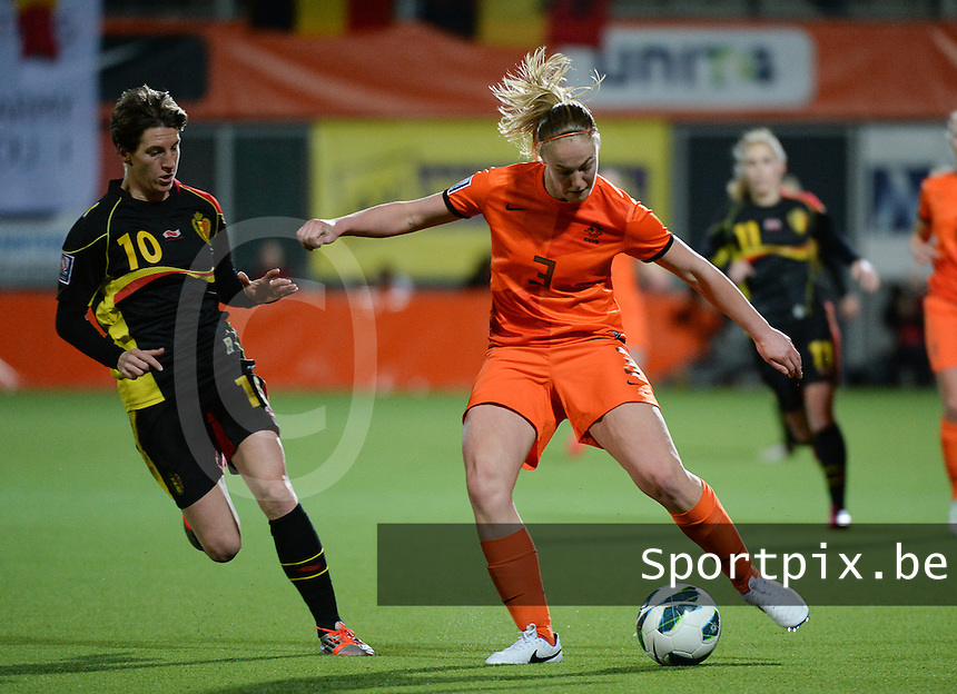 20140212 - ZWOLLE , THE NETHERLANDS : Dutch Stefanie van der Gragt (r) pictured with Belgian Aline Zeler (l) during the female soccer match between The Netherlands and Belgium , on the fifth matchday in group 5 of the UEFA qualifying round to the FIFA Women World Cup in Canada 2015 at Het Ijseldelta Stadion , Zwolle . Wednesday 12th February 2014 . PHOTO DAVID CATRY
