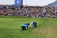 Searching for a ball beside the 9th green during Friday Fourball at the Ryder Cup, Le Golf National, Iles-de-France, France. 28/09/2018.<br /> Picture Thos Caffrey / Golffile.ie<br /> <br /> All photo usage must carry mandatory copyright credit (© Golffile | Thos Caffrey)