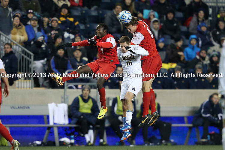 13 December 2013: New Mexico's Nick Miele (5) heads the ball over James Rogers (7) and Notre Dame's Evan Panken (15). The University of Notre Dame Fighting Irish played the University of New Mexico Lobos at PPL Park in Chester, Pennsylvania in a 2013 NCAA Division I Men's College Cup semifinal match. Notre Dame won the game 2-0.