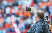 A Rotherham United fan takes a video on his phone before the match <br /> <br /> Photographer Alex Dodd/CameraSport<br /> <br /> The EFL Sky Bet League One - Rotherham United v Blackpool - Saturday 5th May 2018 - New York Stadium - Rotherham<br /> <br /> World Copyright &copy; 2018 CameraSport. All rights reserved. 43 Linden Ave. Countesthorpe. Leicester. England. LE8 5PG - Tel: +44 (0) 116 277 4147 - admin@camerasport.com - www.camerasport.com