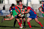 Mathew Hamilton gets picked up and unceremoniously dumped by Harley Crane and George Kupu. Counties Manukau Premier Club Rugby game between Waiuku & Ardmore Marist played at Waiuku on Saturday 20th June, 2009. Waiuku won the game 28 - 25.