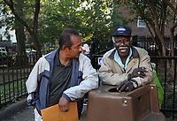 (171015RREI5547) Documentary project La Esquina which will revolve around the history of the Latinos at the corner of Mt. Pleasant St. and Kenyon St. NW. Oscar Hernandez (left) talking with Haitian Mezguy. Washington DC Oct. 15 ,2017 . ©  Rick Reinhard  2017     email   rick@rickreinhard.com