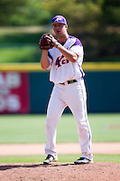 Sam Johns (19) of the Evansville Purple Aces stands on the mound during a game against the Indiana State Sycamores in the 2012 Missouri Valley Conference Championship Tournament at Hammons Field on May 23, 2012 in Springfield, Missouri. (David Welker/Four Seam Images)