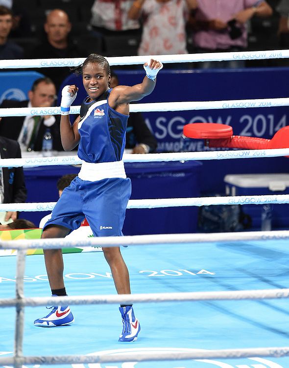 England&rsquo;s Nicola Adams celebrates defeating Northern Ireland&rsquo;s Michaela Walsh in the women&rsquo;s fly (48-51kg) final bout <br /> <br /> Photographer Chris Vaughan/CameraSport<br /> <br /> 20th Commonwealth Games - Day 10 - Saturday 2nd August 2014 - Boxing - The SSE Hydro - Glasgow - UK<br /> <br /> &copy; CameraSport - 43 Linden Ave. Countesthorpe. Leicester. England. LE8 5PG - Tel: +44 (0) 116 277 4147 - admin@camerasport.com - www.camerasport.com