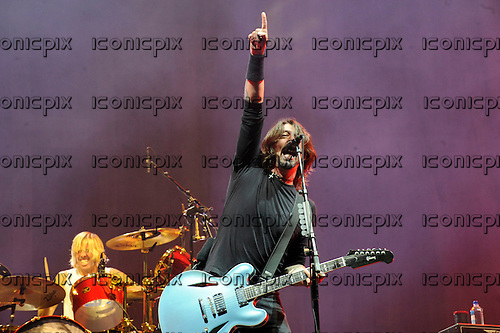 FOO FIGHTERS - vocalist guitarist Dave Grohl performing live on Day Three as the headline act on the Main Stage to close the Reading Festival 2012 at Richfield Avenue Reading UK - 26 Aug 2012.  Photo credit: IconicPix