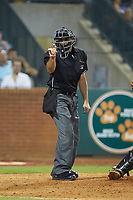 Home plate umpire Thomas Fornarola makes a strike call during the South Atlantic League game between the West Virginia Power and the Greensboro Grasshoppers at First National Bank Field on August 9, 2018 in Greensboro, North Carolina. The Power defeated the Grasshoppers 9-7 in game two of a double-header. (Brian Westerholt/Four Seam Images)