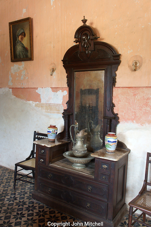 Colonial era antique dresser in the main building at Hacienda Yaxcopoil, Yucatan, Mexico.