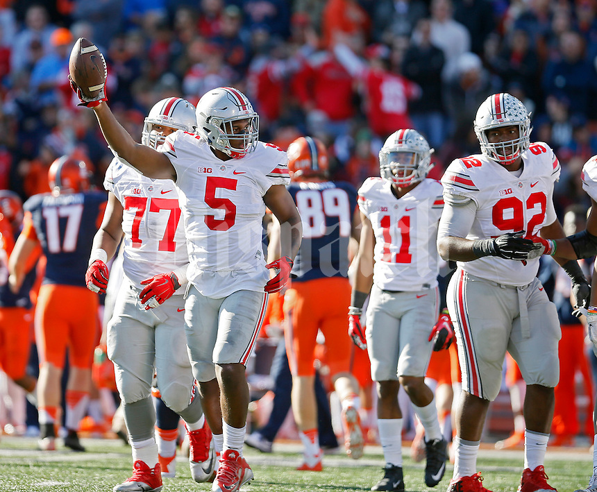 Ohio State Buckeyes linebacker Raekwon McMillan (5) holds the ball up in the air after a fumbled snap on a Illinois Fighting Illini field goal in the second half of their game at Memorial Stadium in Champaign, IL on November 14, 2015.  (Dispatch photo by Kyle Robertson)