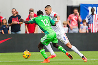 June 07, 2014:   the United States of America forward Clint Dempsey (8) fights for ball control while being defended by Nigeria defender Juwon Oshaniwa (13) during action between the USA Men's National Soccer team and Nigeria at EverBank Field in Jacksonville, Florida.  This is the last match before the USA team leaves for Brazil and the 2014 World Cup Championships. USA defeated Nigeria 2-1.