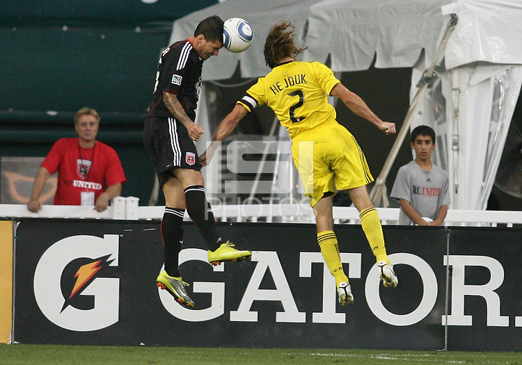 Santino Quaranta #25 of D.C. United goes for a header against Frankie Hejduk #2 of the Columbus Crew during a US Open Cup semi final match at RFK Stadium on September 1 2010, in Washington DC. Columbus won 2-1 aet.
