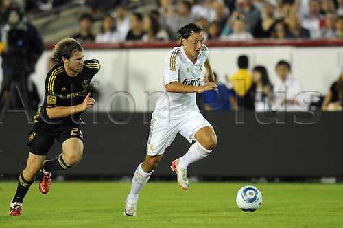 16.07.2011 Real Madrid (10) Mesut Ozil during the World Football Challenge match between Real Madrid and the Los Angeles Galaxy at the Los Angeles Memorial Coliseum in Los Angeles, CA.