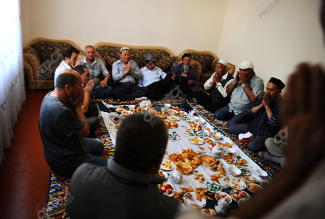 In the south-western area of Osh the residents of one street, mostly Kyrgyz, but also Uzbek, Tartar and Russian said a prayer as they met for a meal of reconciliation, in the aftermath of last week's ethnic violence. Kyrgystan, June 20, 2010