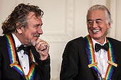 Robert Plant (L) and Jimmy Page of the band Led Zeppelin attend the Kennedy Center Honors reception at the White House on December 2, 2012 in Washington, DC. The Kennedy Center Honors recognized seven individuals - Buddy Guy, Dustin Hoffman, David Letterman, Natalia Makarova, John Paul Jones, Jimmy Page, and Robert Plant - for their lifetime contributions to American culture through the performing arts..Credit: Brendan Hoffman / Pool via CNP