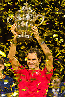 27th October 2019; St. Jakobshalle, Basel, Switzerland; ATP World Tour Tennis, Swiss Indoors Final; Roger Federer (SUI) holds up the winners trophy after winning the match against Alex de Minaur (AUS) - Editorial Use