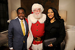 Antonio Miller and Dorothy Azubuko with Santa at the M.D. Anderson Santa's Elves party Thursday Dec. 07,2017. (Dave Rossman Photo)
