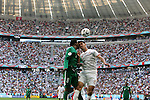 14 June 2006: Mohammed Noor (KSA) (left) and Karim Haggui (TUN) (right) challenge for a header in front of a full house in Munich. Tunisia tied Saudi Arabia 2-2 at the Allianz Arena in Munich, Germany in match 16, a Group H first round game, of the 2006 FIFA World Cup.