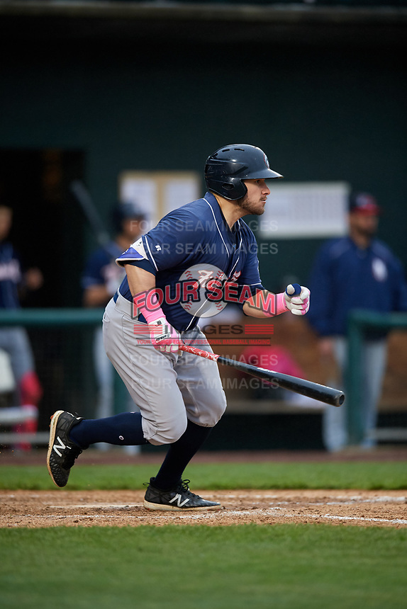 New Hampshire Fisher Cats left fielder Connor Panas (15) follows through on a swing during the second game of a doubleheader against the Harrisburg Senators on May 13, 2018 at FNB Field in Harrisburg, Pennsylvania.  Harrisburg defeated New Hampshire 2-1.  (Mike Janes/Four Seam Images)